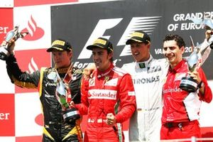 Kimi Raikkonen, Lotus F1, Fernando Alonso, Ferrari, Michael Schumacher, Mercedes AMG F1 and Andrea Stella, Ferrari Race Engineer celebrate on the podium