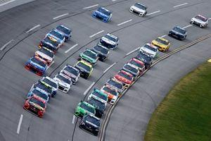 Denny Hamlin, Joe Gibbs Racing, Toyota Camry and Martin Truex Jr., Joe Gibbs Racing, Toyota Camry lead the field at the race start