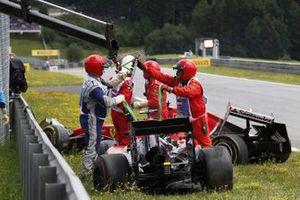 Marshal's remove the carsof Fernando Alonso, McLaren MP4-30 Honda after his crash with Kimi Raikkonen, Ferrari SF-15T