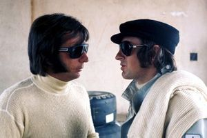 Emerson Fittipaldi, Lotus talks with Jackie Stewart, Tyrrell