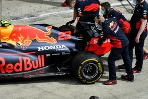 Car of Alex Albon, Red Bull Racing RB16 being pushed by Red Bull Racing Mechanics