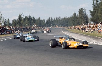 Peter Gethin, McLaren M14A Ford, leads Henri Pescarolo, Matra MS120 and François Cevert, March 701 Ford