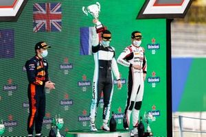 Liam Lawson, Hitech Grand Prix, race Winner Jake Hughes, HWA Racelab and Theo Pourchaire, ART Grand Prix celebrate on the podium with the trophy