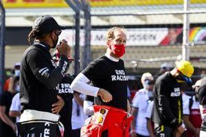 Lewis Hamilton, Mercedes-AMG F1, and Sebastian Vettel, Ferrari, on the grid