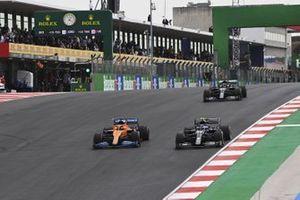 Carlos Sainz Jr., McLaren MCL35, Valtteri Bottas, Mercedes F1 W11, and Lewis Hamilton, Mercedes F1 W11