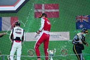 Theo Pourchaire, ART Grand Prix, Race Winner Frederik Vesti, Prema Racing and Oscar Piastri, Prema Racing celebrate on the podim with the champagne