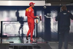 Pole man Sebastian Vettel, Ferrari, is weighed after Qualifying