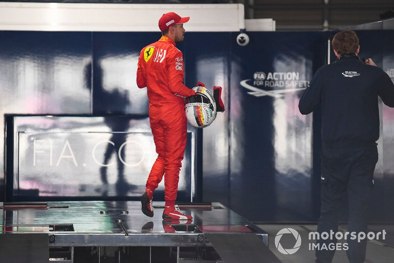 Pole man Sebastian Vettel, Ferrari, is weighed after Qualifying