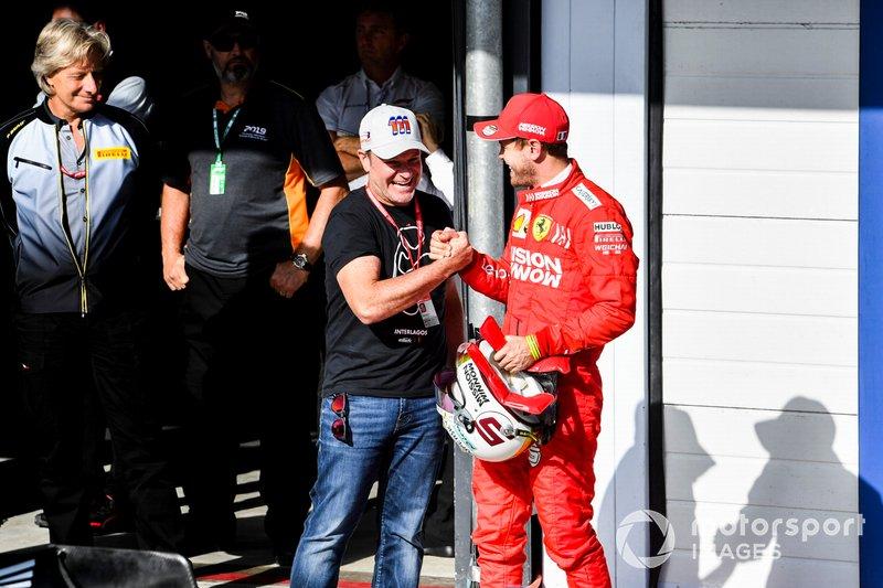 Rubens Barrichello e Sebastian Vettel, Ferrari, festeggiano nel parco chiuso
