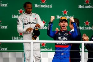 Pierre Gasly, Toro Rosso celebrates on the podium with Lewis Hamilton, Mercedes AMG F1