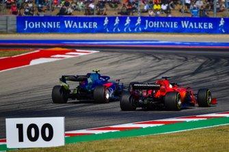 Pierre Gasly, Toro Rosso STR14, overtakes Sebastian Vettel, Ferrari SF90