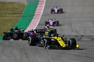 Nico Hulkenberg, Renault F1 Team R.S. 19, leads Romain Grosjean, Haas F1 Team VF-19, and Daniil Kvyat, Toro Rosso STR14