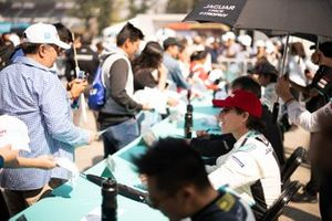 Mario Dominguez, Jaguar VIP car signs autographs for fans