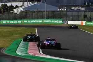 Daniel Ricciardo, Renault F1 Team R.S.19, leads Sergio Perez, Racing Point RP19