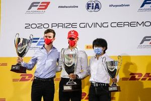 F2 Championship 2nd position Callum Ilott, UNI-Virtuosi 1st postion Mick Schumacher, Prema Racing and 3rd position Yuki Tsunoda, Carlin celebrate on the podium with the trophy