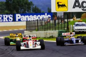 Ayrton Senna, McLaren MP4-8, leads Alain Prost, Williams FW15C, and Michael Schumacher, Benetton B193A