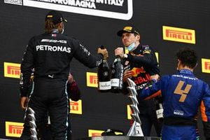 Lewis Hamilton, Mercedes, 2nd position, Max Verstappen, Red Bull Racing, 1st position, and Lando Norris, McLaren, 3rd position, congratulate each other on the podium