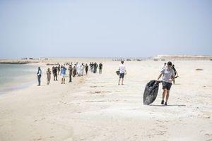 The Extreme E beach clean in progress