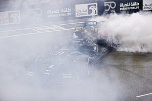 Valtteri Bottas, Mercedes F1 W11, 2nd position, performs celebratory donuts on the grid after the race