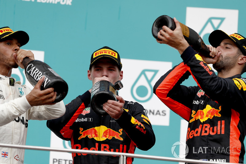 Second place Lewis Hamilton, Mercedes AMG F1, Max Verstappen, Red Bull Racing, race winner, third place Daniel Ricciardo, Red Bull Racing, drink a Champagne toast on the podium