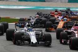Esteban Ocon, Sahara Force India F1 VJM10, Felipe Massa, Williams FW40, Fernando Alonso, McLaren MCL32, Kevin Magnussen, Haas F1 Team VF-17 at the start