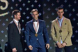 Top three in Moto2: Champion Johann Zarco, Ajo Motorsport; second place Thomas Lüthi, Garage Plus In