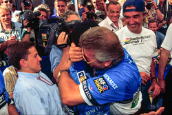 Race winner Micheal Schumacher, Benetton, celebrates with his manager Willi Weber and Flavio Briator