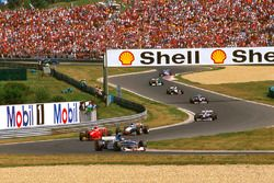 Damon Hill, Arrows A18 Yamaha, Eddie Irvine, Ferrari F310B and Mika Hakkinen, McLaren MP4/12 Mercedes
