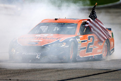 Brad Keselowski, Team Penske Ford, celebrates with a burnout after winning