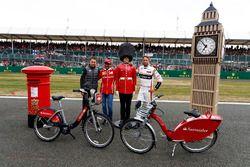 Stoffel Vandoorne, McLaren, MarcGene of Ferrari and Jenson Button, McLaren, with a dummy Scots Guard