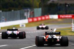 Fernando Alonso, McLaren MCL32, Pierre Gasly, Scuderia Toro Rosso STR12, leave the pits