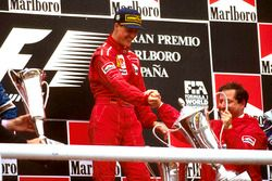 Race winner Michael Schumacher, Ferrari celebrates on the podium with team boss Jean Todt