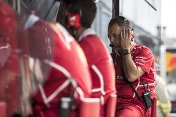 Ferrari engineer on the pitwall gantry