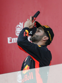 Race winner Daniel Ricciardo, Red Bull Racing celebrates on the podium and does a shoey, the champagne