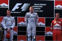 Podium: second place David Coulthard, McLaren, Race winner Mika Hakkinen, McLaren, third place Rubens Barrichello, Ferrari