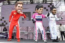 Des caricatures de Sebastian Vettel, Ferrari, Sergio Perez, Force India, Lewis Hamilton, Mercedes-AMG F1
