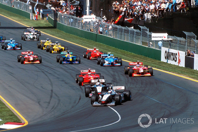 Mika Hakkinen, McLaren Mercedes MP4/13 leads team mate David Coulthard, McLaren Mercedes MP4/13 into