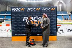Mansour Chebli, is presented with a trophy by Prince Khaled Al Faisal, President of the Motor Federa