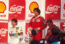 Podium: race winner Alain Prost, McLaren, second place Nelson Piquet, Williams, third place Stefan J