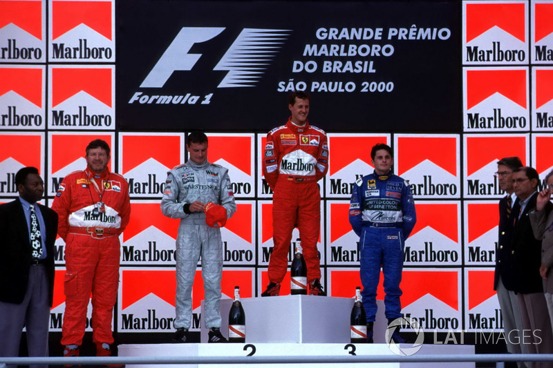 Podium: Race winner Michael Schumacher, Ferrari, second place David Coulthard, McLaren, third place Giancarlo Fisichella, Benetton, with footballer Pele and Ferrari Technical Director Ross Brawn