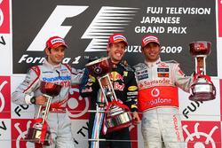 The podium: Jarno Trulli, Toyota, second; Sebastian Vettel, Red Bull Racing, race winner; Lewis Hamilton, McLaren, third