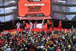 Driver caricatures on stage in the Fanzone