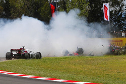Pierre Gasly, Toro Rosso STR13, and Nico Hulkenberg, Renault Sport F1 Team R.S. 18, collect the spinning Romain Grosjean, Haas F1 Team VF-18