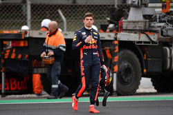 Max Verstappen, Red Bull Racing walks in after spinning into the gravel