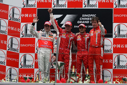 Podium: second place Fernando Alonso, McLaren, Race winner Kimi Raikkonen, Ferrari, third place Felipe Massa, Ferrari and Rob Smedley, Ferrari Race Engineer