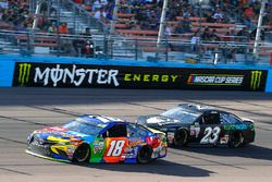 Kyle Busch, Joe Gibbs Racing Toyota and Corey LaJoie, BK Racing Toyota