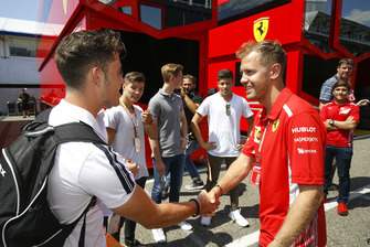 Joey Alders with Sebastian Vettel