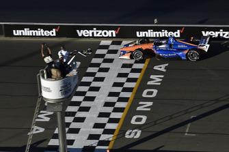 Scott Dixon, Chip Ganassi Racing Honda crosses the finish line under the checkered flag for the championship win