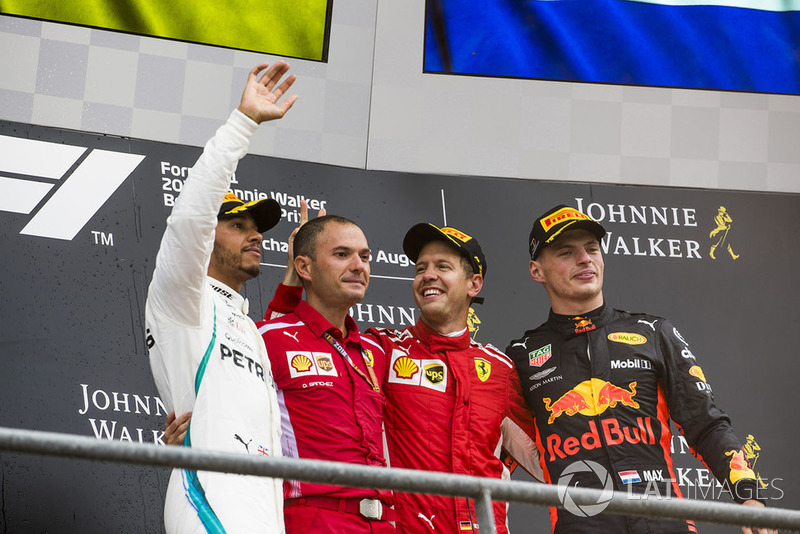 Lewis Hamilton, Mercedes AMG F1, 2nd position, David Sanchez, Principal Aerodynamicist, Ferrari, Sebastian Vettel, Ferrari, 1st position, and Max Verstappen, Red Bull Racing, 3rd position, celebrate on the podium