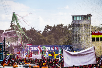 Streamers and Confetti hang in the air as Kimi Raikkonen, Ferrari, second position, Lewis Hamilton, Mercedes AMG F1, first position, and Valtteri Bottas, Mercedes AMG F1, third position, celebrate on the podium